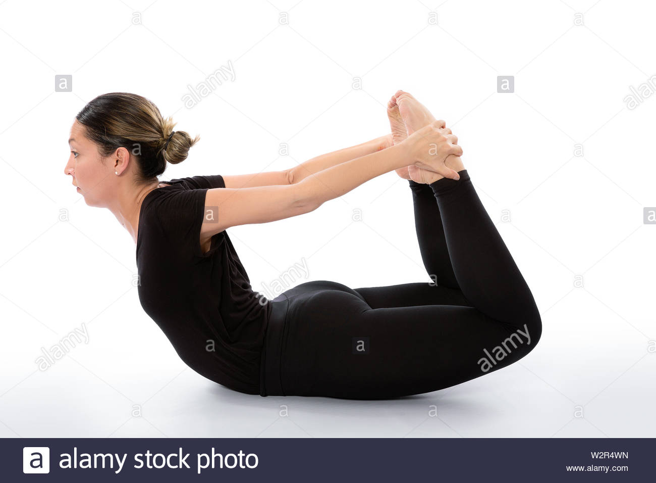Dhanurasana yoga pose (Bow pose). Yoga poses woman isolated with white background. Yoga pose set. Mindfulness and Spiritually concept. Girl practicing Stock Photo