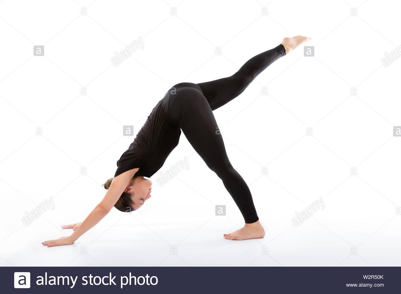 Eka Pada Adho Mukha Svanasana pose (Downward facing dog split). Yoga poses woman isolated with white background. Yoga pose set. Mindfulness and Spirit - Stock Image