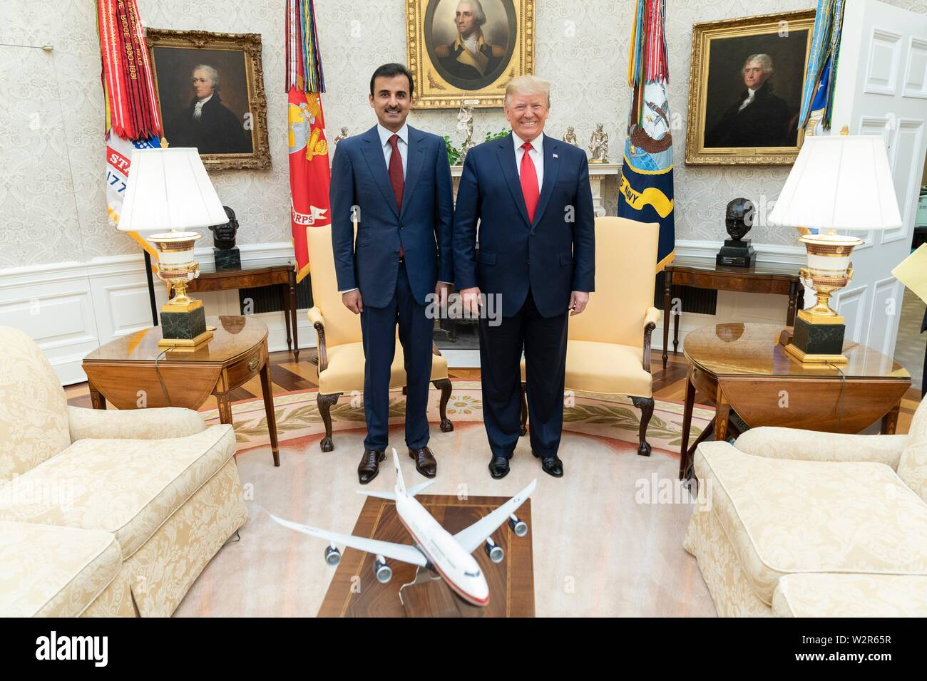 A model of a Boeing 747 is on display as U.S President Donald Trump holds a bilateral meeting with the Emir of Qatar Tamin bin Hamad Al Thani at the Oval Office of the White House July 9, 2019 in Washington, DC. - Stock Image