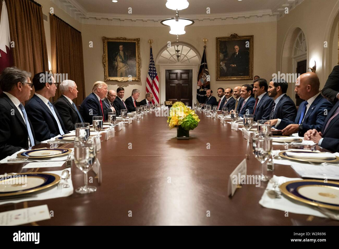 U.S President Donald Trump, joined by Vice President Mike Pence and Cabinet members, participate in an expanded working luncheon with the Emir of Qatar, Tamin bin Hamad Al Thani and delegates at the Cabinet Room of the White House July 9, 2019 in Washington, DC. - Stock Image