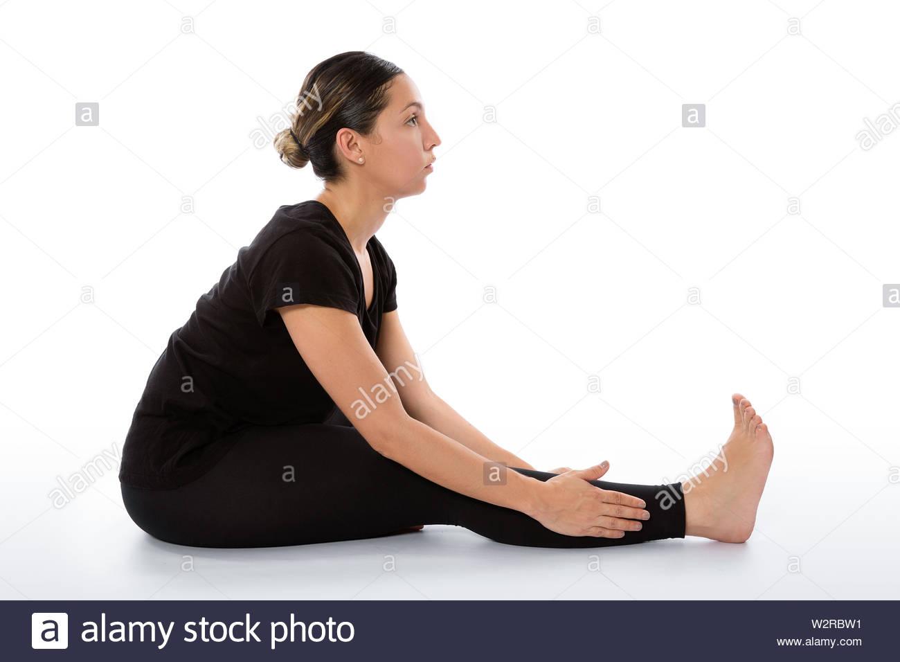 Paschimottanasana yoga pose (Seated Forward Bend pose). Yoga poses woman isolated with white background. Yoga pose set. Mindfulness and Spiritually co Stock Photo