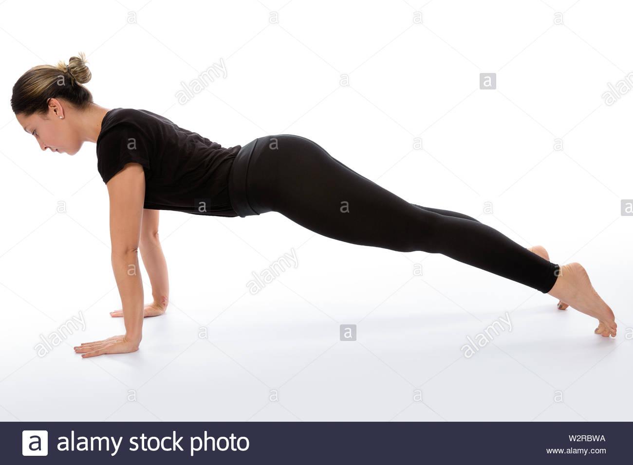 Phalakasana yoga pose (plank pose). Yoga poses woman isolated with white background. Yoga pose set. Mindfulness and Spiritually concept. Girl practici - Stock Image