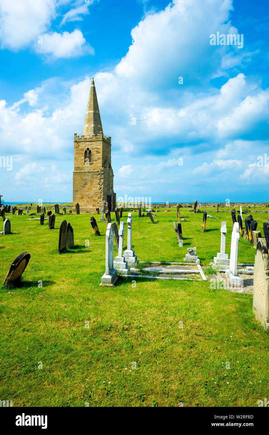 The tower and spire of St Germain's church Marske by the Sea a Grade 2 listed building built in 1160 the rest demolished 1950 in the church grave yard - Stock Image