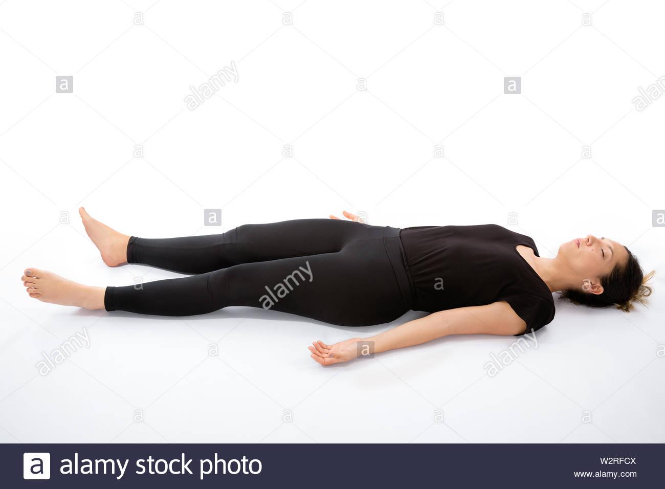 Shavasana pose. Yoga poses woman isolated with white background. Yoga pose set. Mindfulness and Spiritually concept. Girl practicing Hatha Yoga asanas - Stock Image