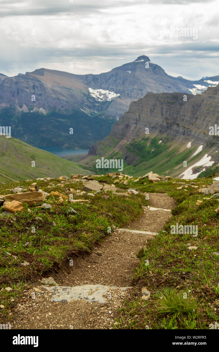 A personal point of view of hiking down into the head of Baring Creek, above the Sunrift Gorge, Glacier National Park, Montana, USA. - Stock Image