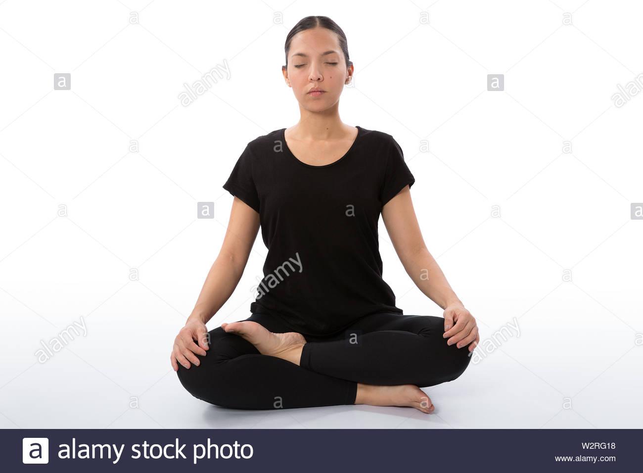 Sukhasana pose (half lotus pose). Meditation Pose. Yoga poses woman isolated with white background. Yoga pose set. Mindfulness and Spiritually concept - Stock Image