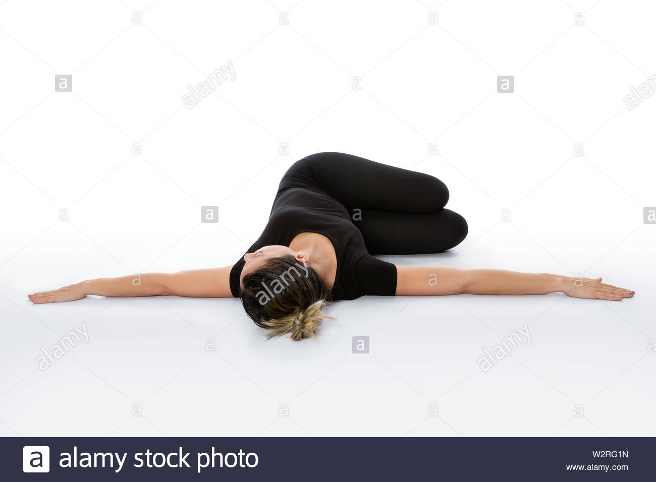 Supta Matsyendrasana yoga pose (Reclined Spinal Twist pose). Yoga poses woman isolated with white background. Yoga pose set. Mindfulness and Spiritual Stock Photo