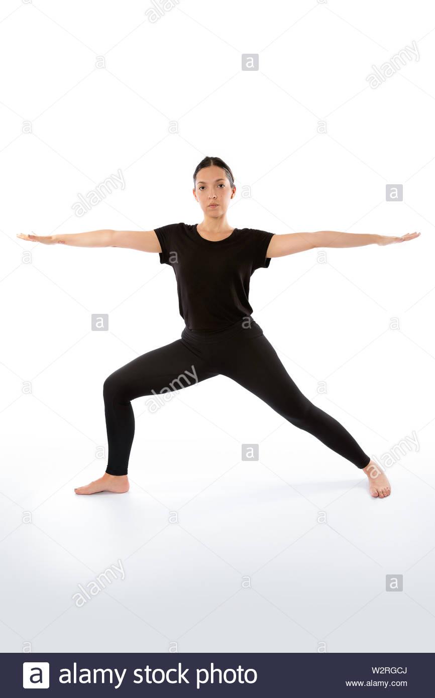 Virabhadrasana (warrior pose). Yoga poses woman isolated with white background. Yoga pose set. Mindfulness and Spiritually concept. Girl practicing Ha - Stock Image