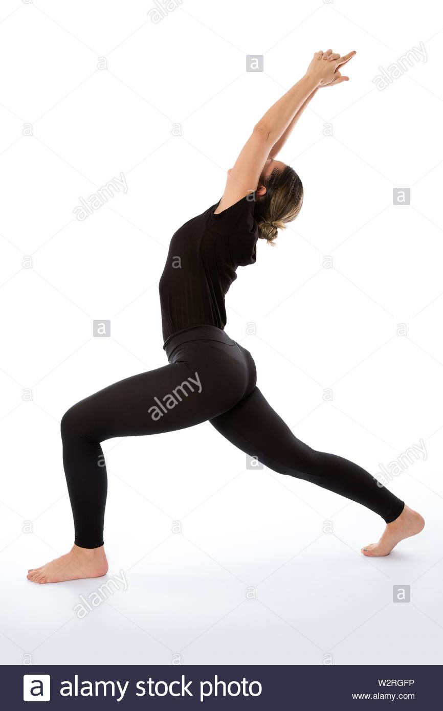 Virabhadrasana yoga pose (Warrior Pose).Yoga poses woman isolated with white background. Yoga pose set. Mindfulness and Spiritually concept. Girl prac Stock Photo