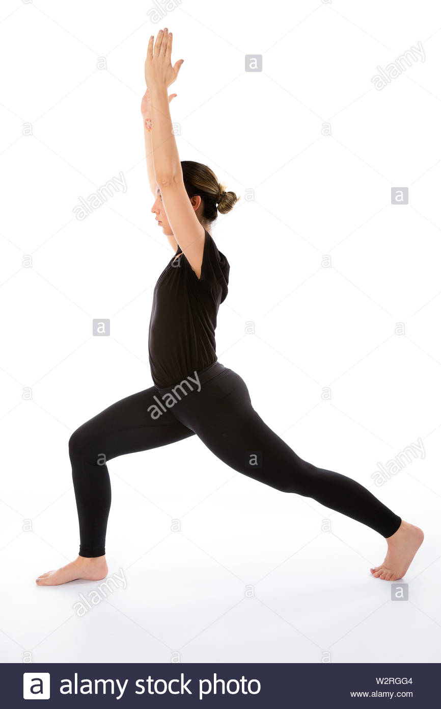 Virabhadrasana yoga pose (Warrior Pose).Yoga poses woman isolated with white background. Yoga pose set. Mindfulness and Spiritually concept. Girl prac - Stock Image
