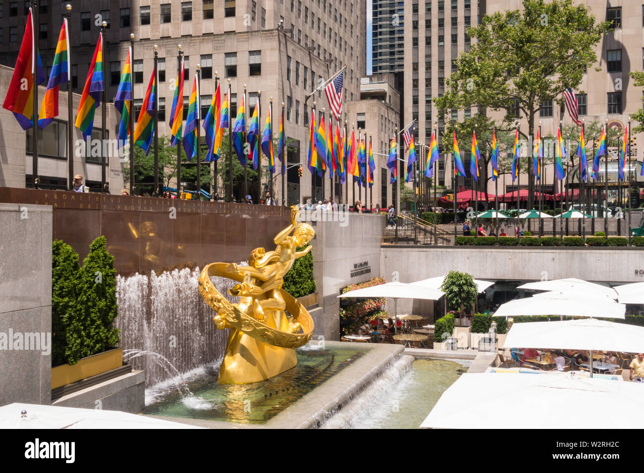 Rainbow color flags celebrate WorldPride at Rockefeller Center Plaza, NYC, USA Stock Photo