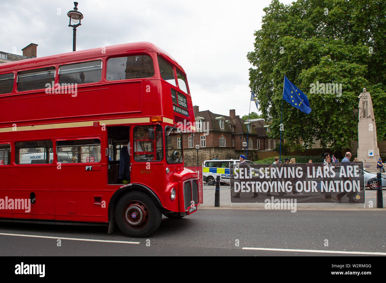 Westminster, London. 9th July, 2019. A vintage London red bus passes the Brexit Remainers campaign sign opposite the House of Commons. Credit: Maureen McLean/Alamy - Stock Image
