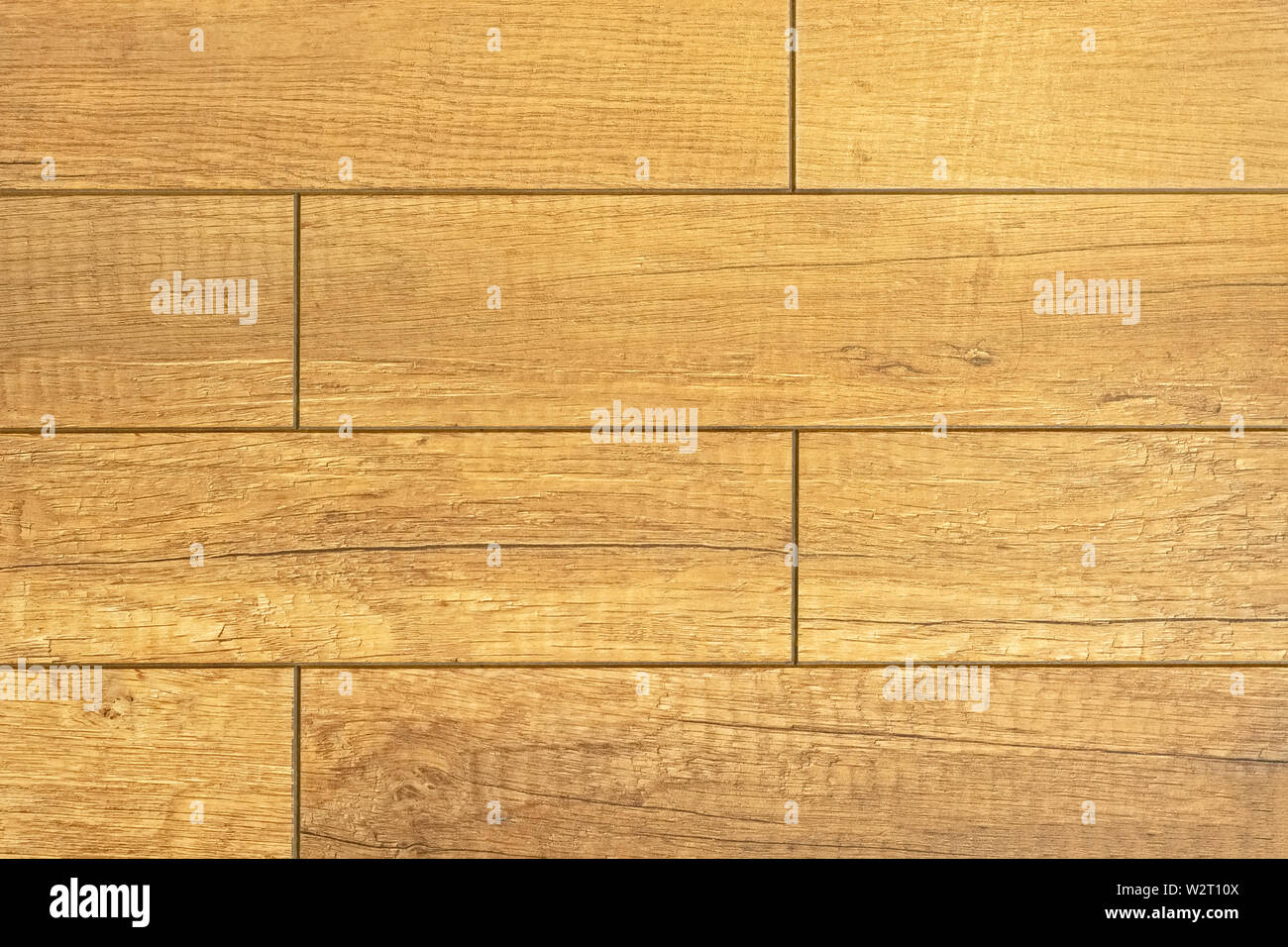 Fragment of a floor laid out with a parquet from wooden plates, for use as a texture and an abstract background. - Stock Image