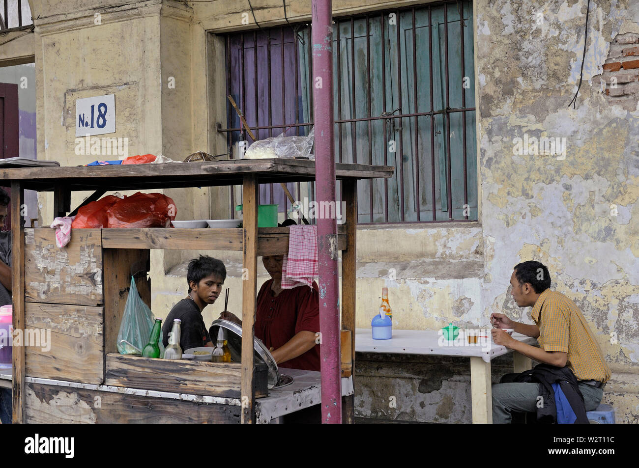 jakarta, dki jakarta/indonesia - may 19, 2010:  people having their lunch at a  mobile foodstall   in jakarta kota tua old town - Stock Image