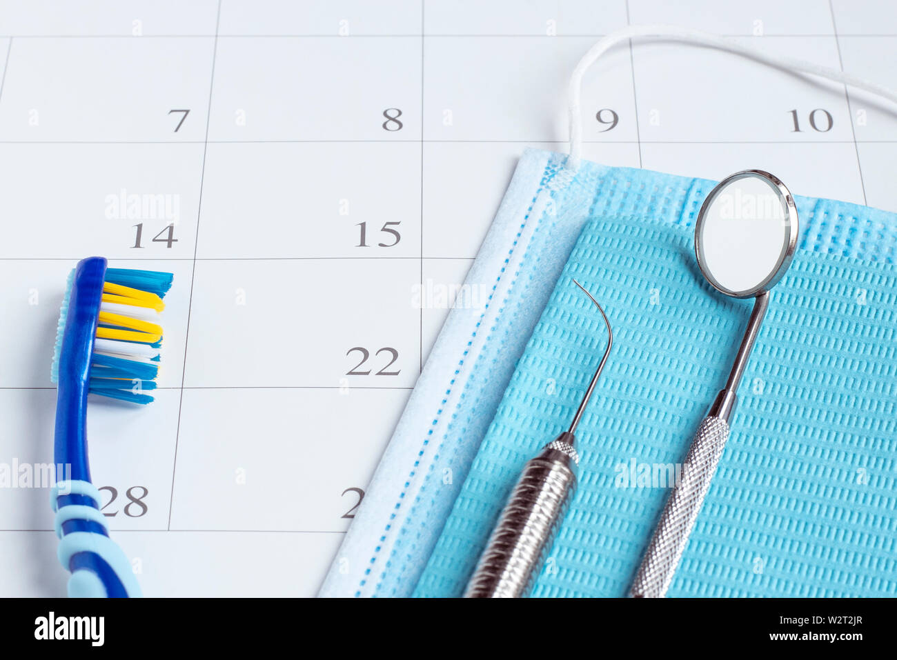 Dentist appointment reminder in calendar toothbrush and