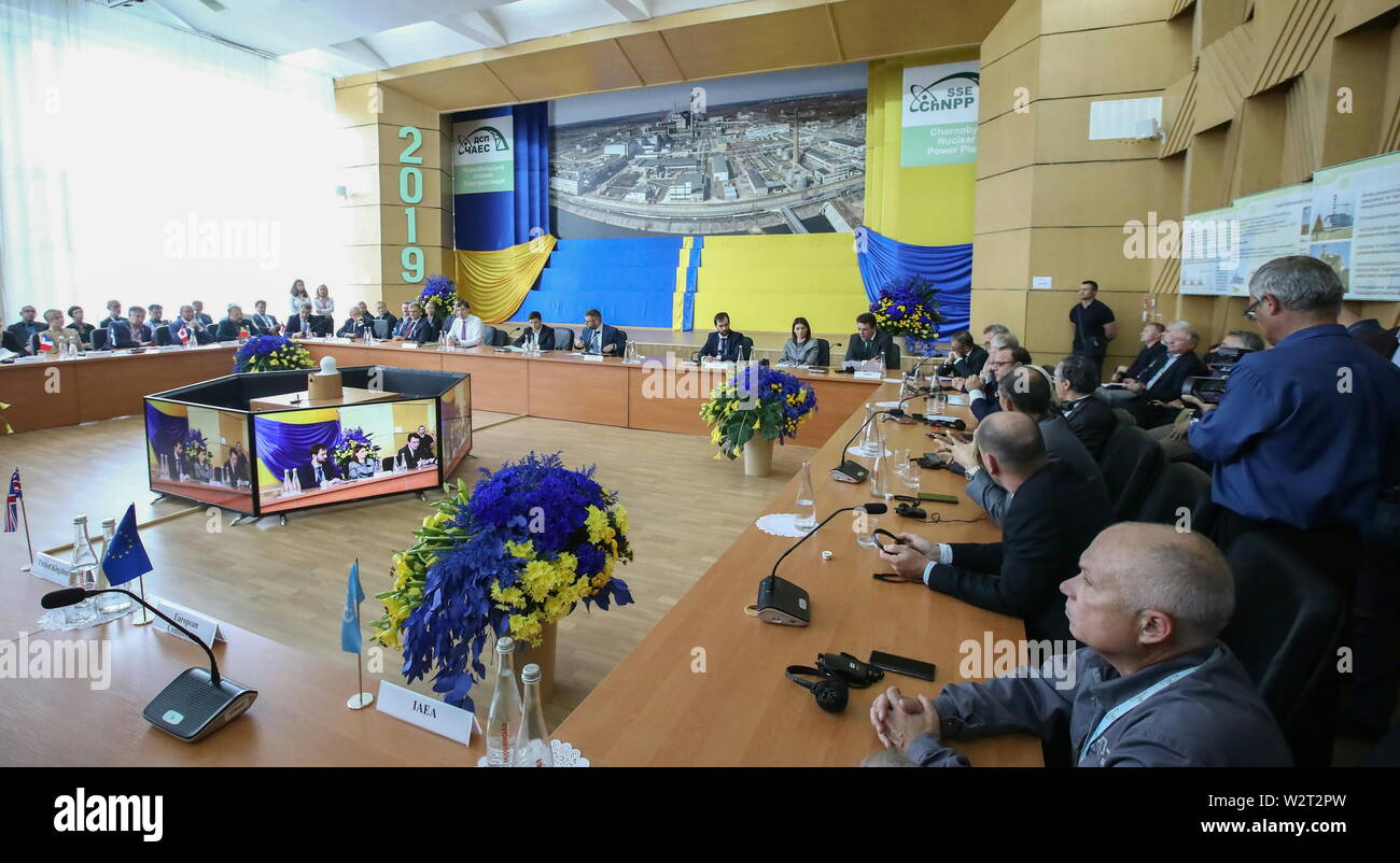 Pripyat, Ukraine. 10th July, 2019. PRIPYAT, UKRAINE - JULY 10, 2019: A meeting of EU and Ukraine officials and representatives of international organisations marking the official handover to the Ukraine authorities of the new mobile metal structure, offically known as the New Safe Confinement, built over Reactor 4 of the Chernobyl Nuclear Power Plant; the construction of the 1.5bn euro metal shelter began in 2012; Reactor 4 is the site of the 1986 Chernobyl disaster. Pyotr Sivkov/TASS Credit: ITAR-TASS News Agency/Alamy Live News - Stock Image