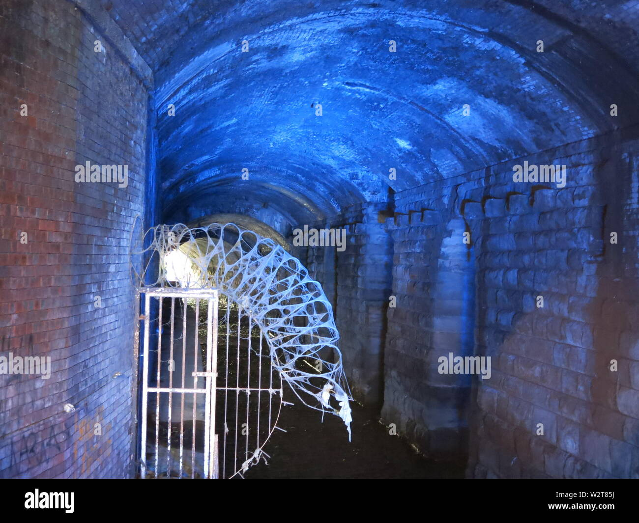 The brick-lined tunnel complex known as 'Dark Arches' sits below Leeds Railway Station, & was formerly used as wharves for the Leeds & Liverpool Canal Stock Photo