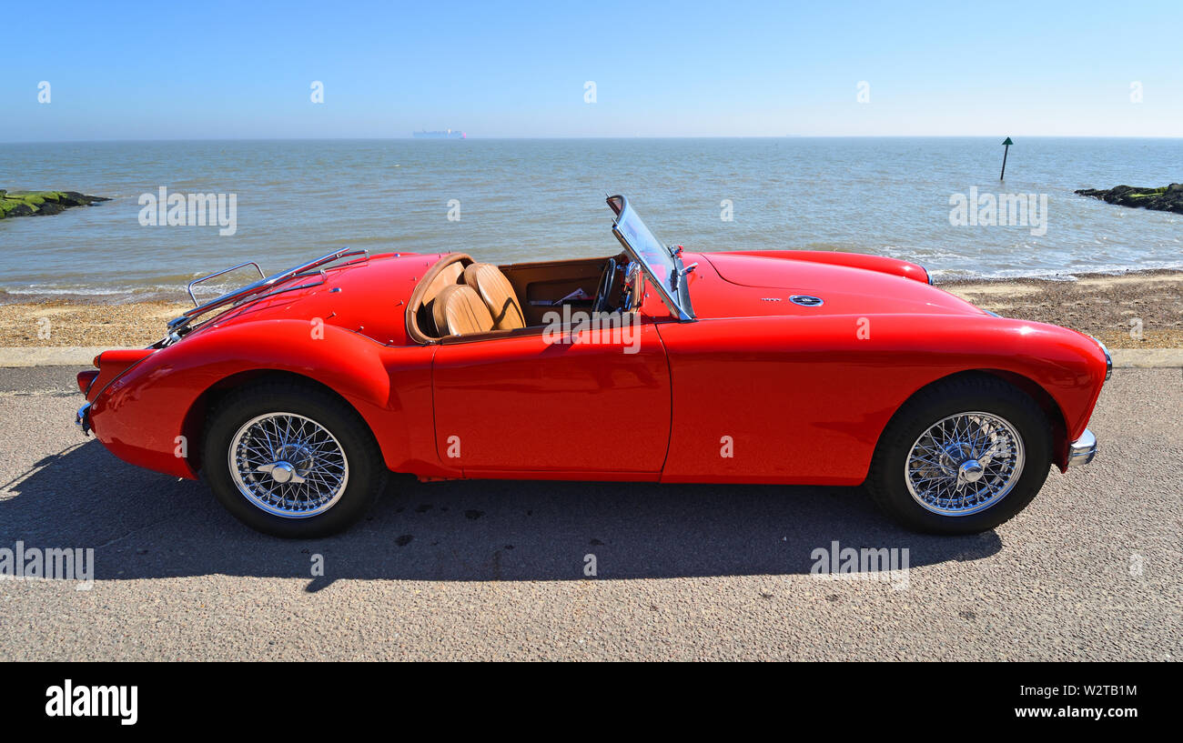 Classic Red MG A Motor Car Parked on Seafront Promenade. - Stock Image