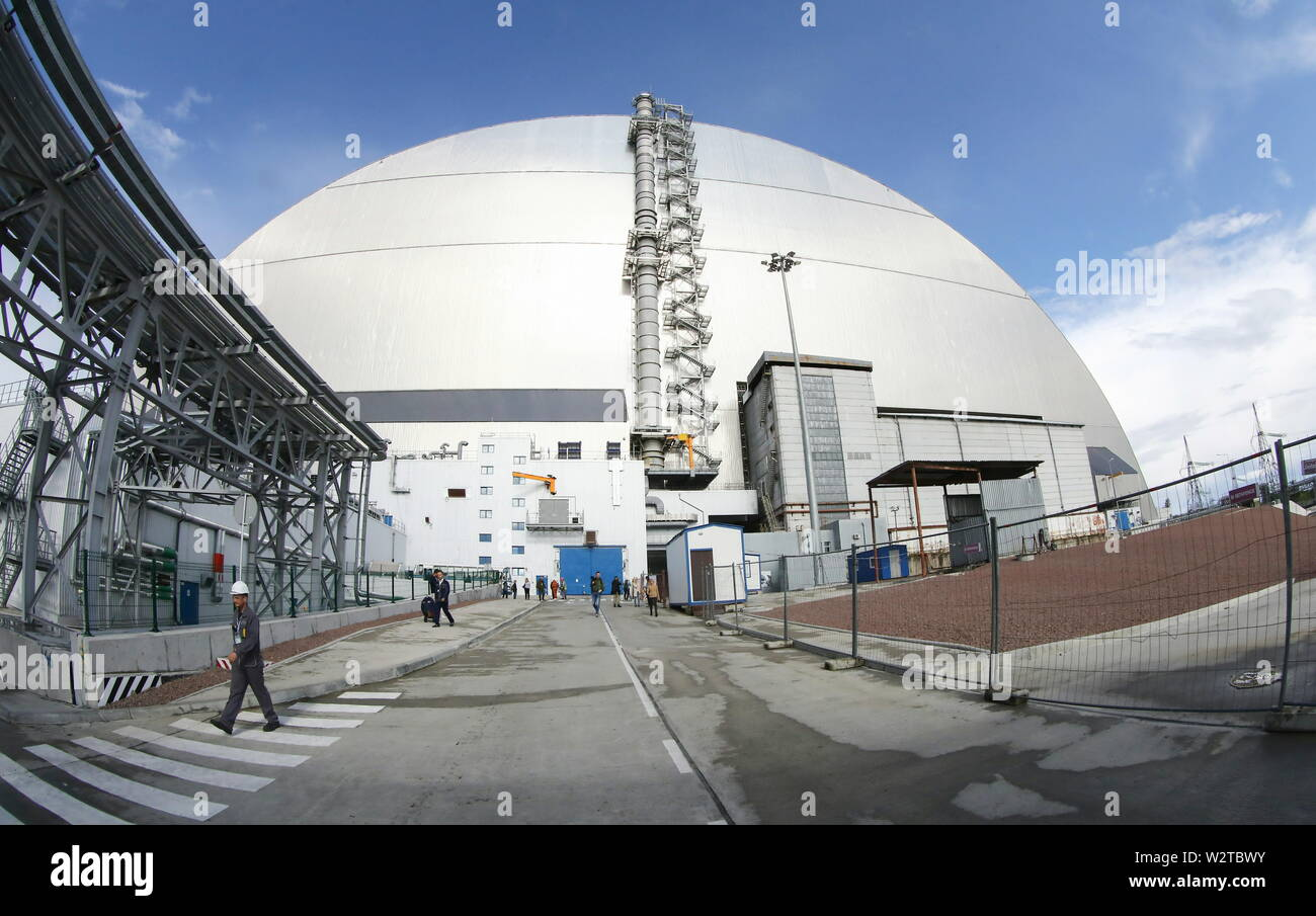 Pripyat, Ukraine. 10th July, 2019. PRIPYAT, UKRAINE - JULY 10, 2019: Outside view of the new mobile metal structure, officially known as the New Safe Confinement, built over Reactor 4 of the Chernobyl Nuclear Power Plant, the new metal shelter has been officially handed over by the EU to the Ukrainian authorities; the construction of the 1.5bn euro metal shelter began in 2012; Reactor 4 is the site of the 1986 Chernobyl disaster. Pyotr Sivkov/TASS Credit: ITAR-TASS News Agency/Alamy Live News - Stock Image