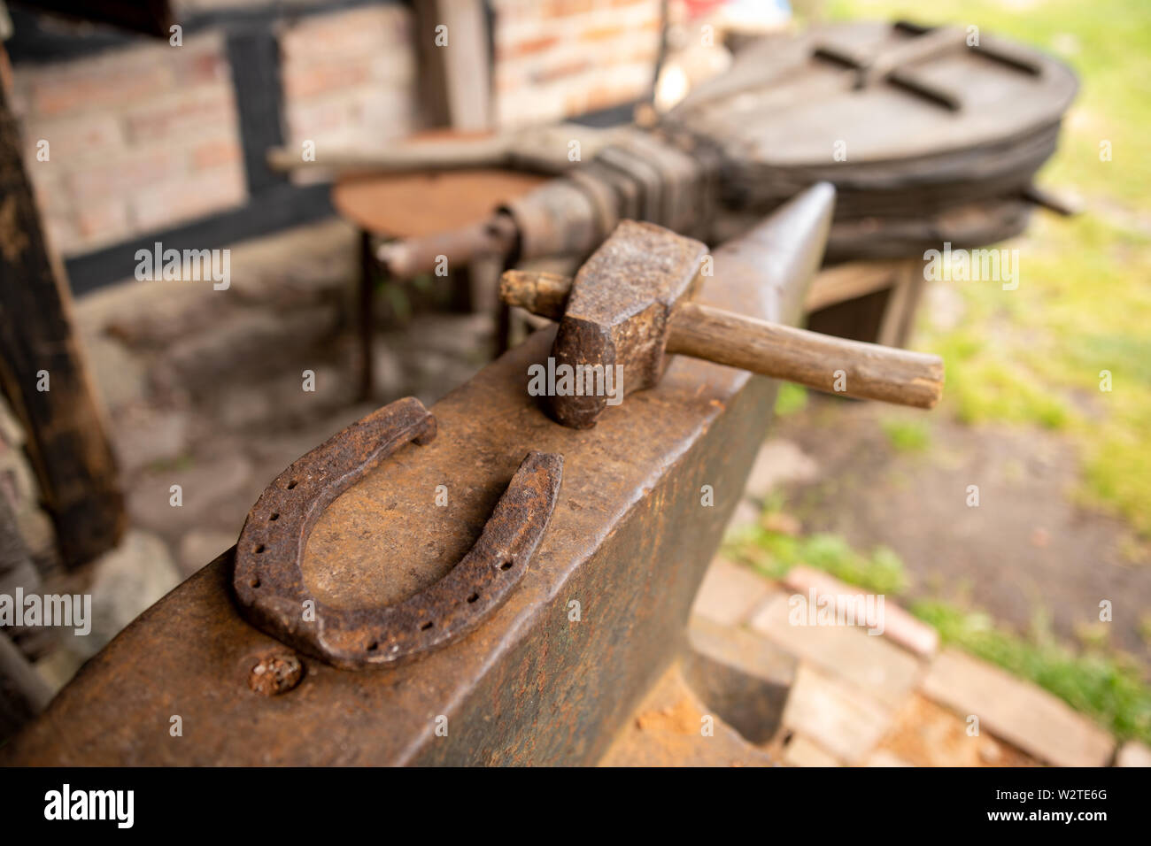 Tools in an old blacksmith's workshop  Horseshoe and hammer on a