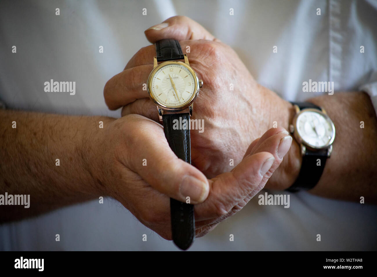 """The watch «Simplicity» is regarded by many to be the reference for mechanical watches. The secret is in the details, the rounded edges, the finish. The man behind the watch, Philippe Dufour, sees himself as a bit of a troublemaker in the industry. """"Watchmakers like me demonstrate for the customers how good a mechanical watch can get,"""" he says. - Stock Image"""