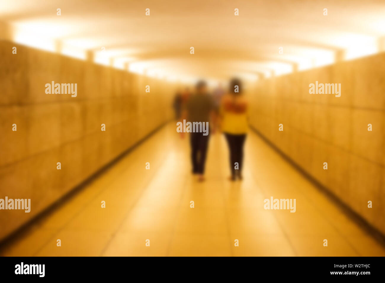 Strong blur, anonymous people on the streets of Europe. pedestrian underground infrastructure tunnel - Stock Image