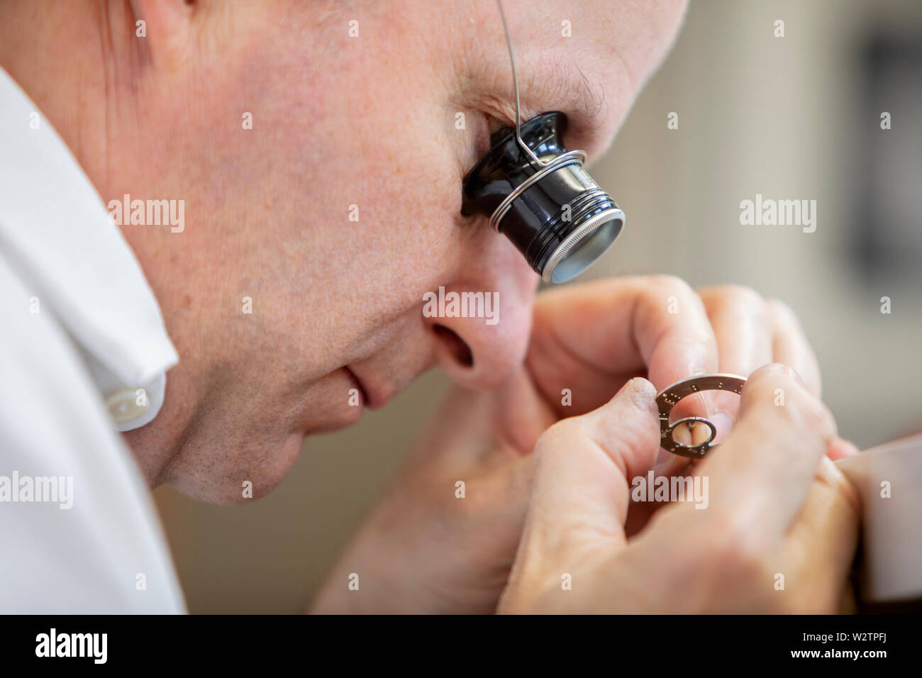 Kari Voutilainen moved from Finland to Switzeland to pursue the art of watchmaking. He is now regarded as one of the best watchmakers in Switzerland. - Stock Image