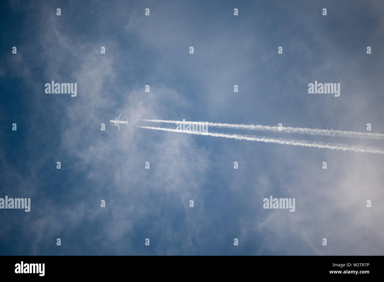 Trace of jet plane and clouds in Poland. June 25th 2019 © Wojciech Strozyk / Alamy Stock Photo - Stock Image