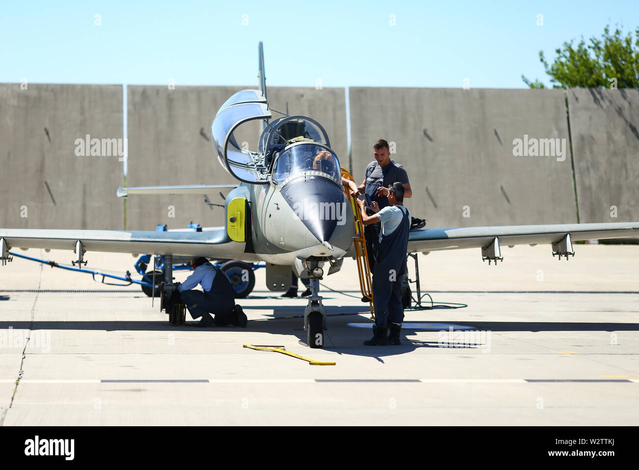 Boboc, Romania - May 22, 2019: Mechanics attend IAR 99 Soim (Hawk) advanced trainer and light attack airplane, used as jet trainer of the Romanian Air Stock Photo