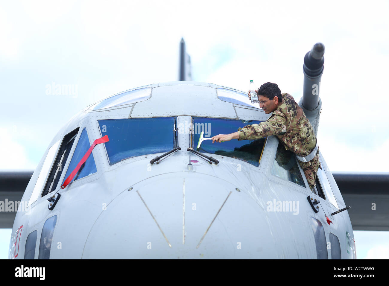 Otopeni, Romania - May 22, 2019: A military pilot of an Alenia C-27J Spartan military cargo plane from the Italian Air Force is cleaning the windscree Stock Photo