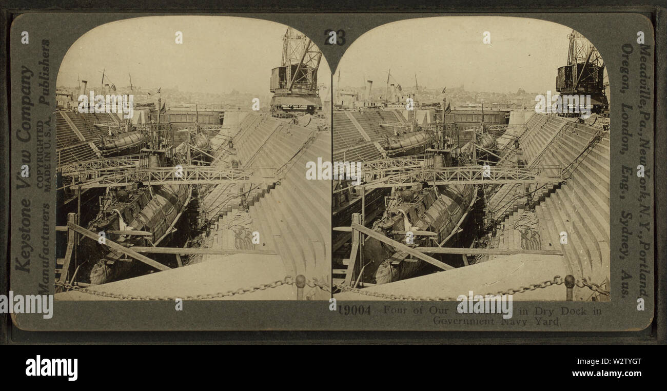 Four of our submarines in Dry Dock in Government Navy Yard, by Keystone View Company - Stock Image