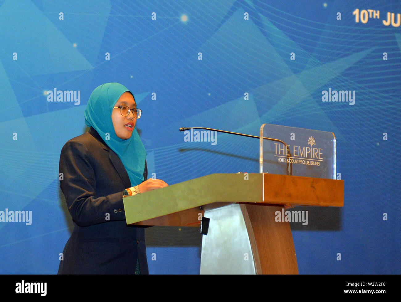 (190710) -- BANDAR SERI BEGAWAN, July 10, 2019 (Xinhua) -- A scholarship recipient gives a speech during a graduation ceremony for the fifth batch of 11 scholarship students under the Joint Chemical and Process Engineering Scholarship Program provided by Hengyi Industries Sdn Bhd, in Bandar Seri Begawan, capital of Brunei, July 10, 2019. Hengyi Industries Sdn Bhd, a China-Brunei joint venture, hopes to provide at least 50 percent of over 2,000 new jobs to local Bruneians in the second phase of Pulau Muara Besar (PMB) refinery and petrochemical plant, Li Peng, director of General Affairs of Hen - Stock Image