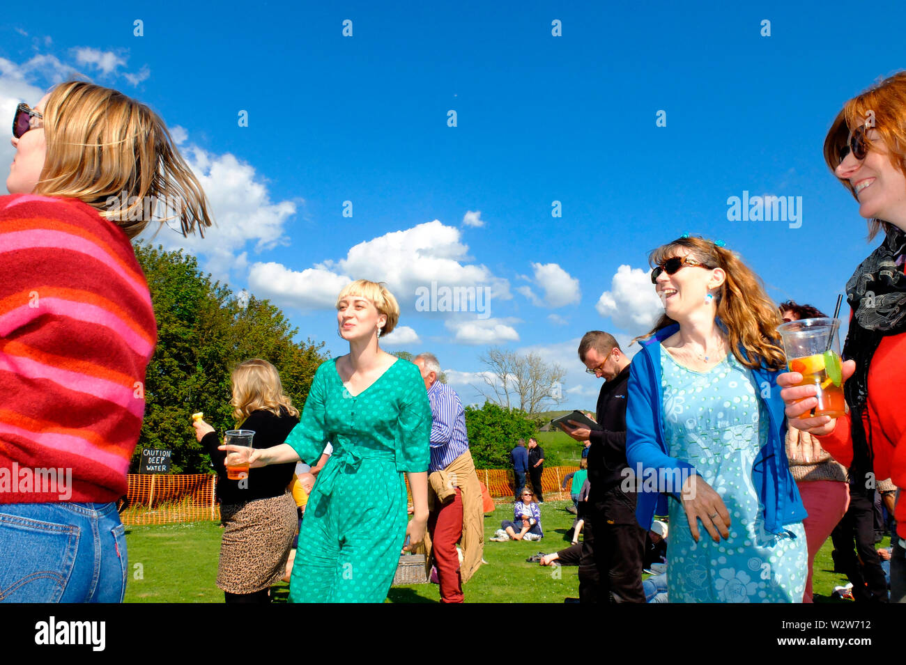 Revellers dancing at the Wolverton Folk and Blues Fair 2019 on the grounds of Wolverton Manor, Shorwell, Isle of Wight, England, UK. Stock Photo
