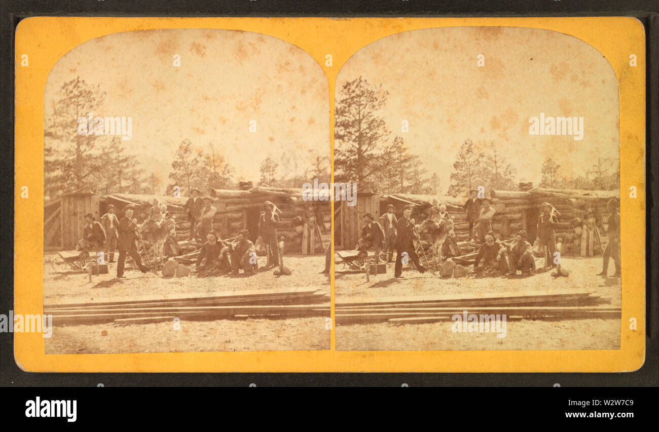 Group of men in front of a log cabin, by F E Evans - Stock Image