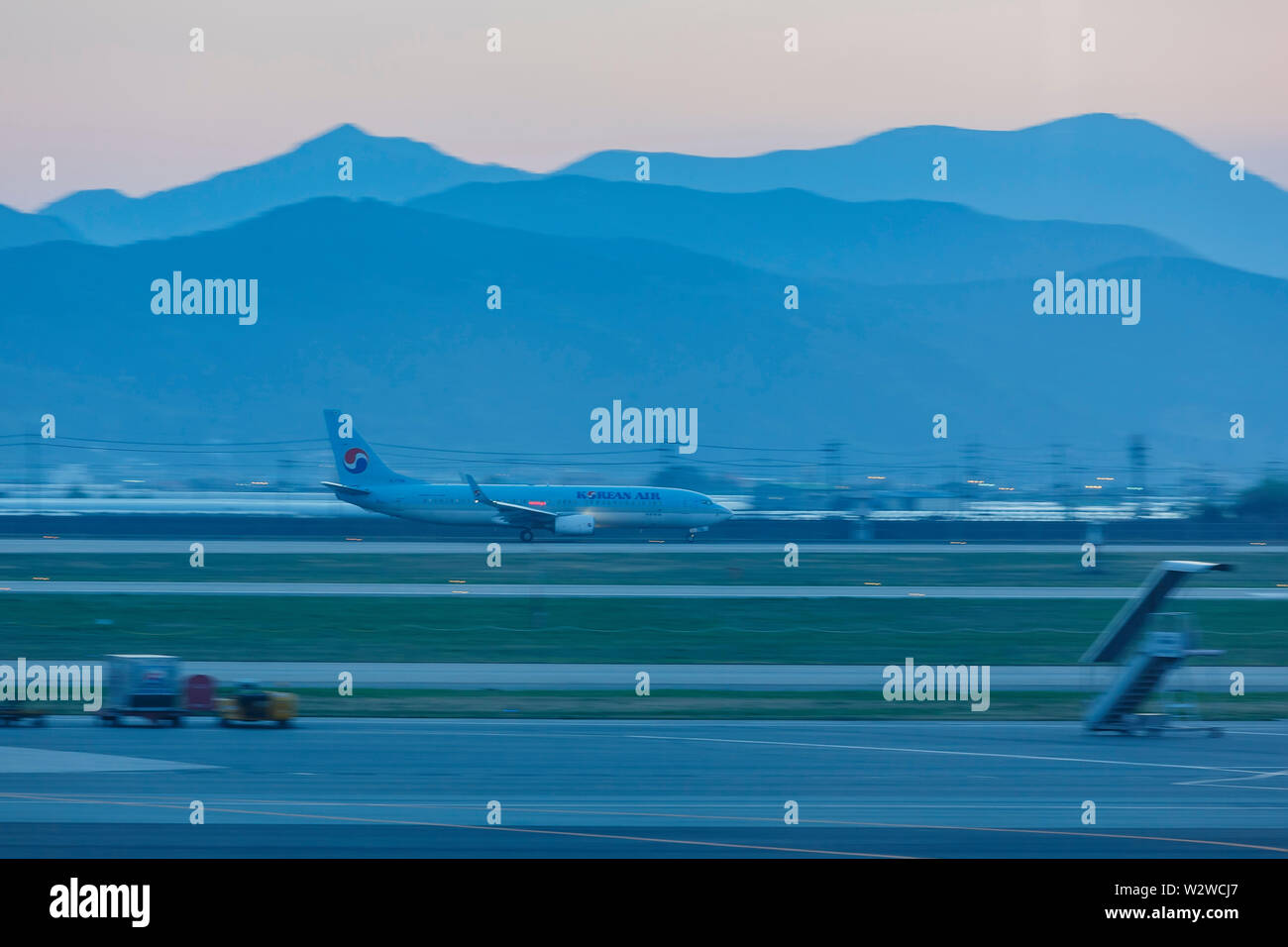 Busan, APR 5: Korean Air's airplane is taking off from an airstrip on APR 5, 2014 at Busan, South Korea - Stock Image