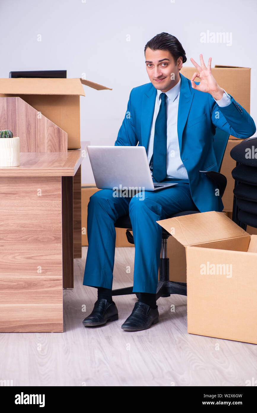 The young handsome businessman being fired from his work - Stock Image