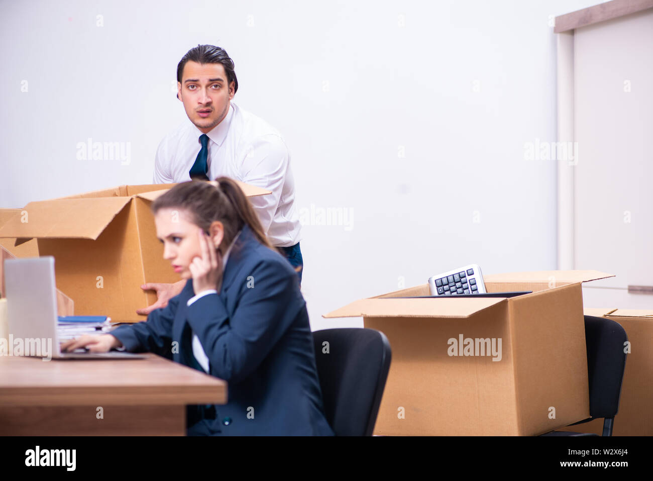 The two employees being fired from their work - Stock Image