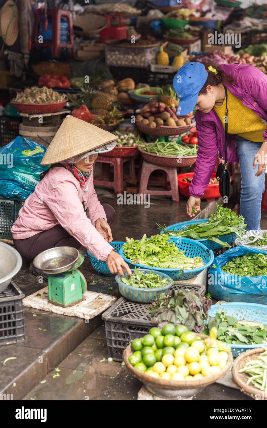 HOI AN, VIETNAM - JANUARY 03, 2019 : Fresh vegetables in traditional street market in Hoi An, Vietnam - Stock Image