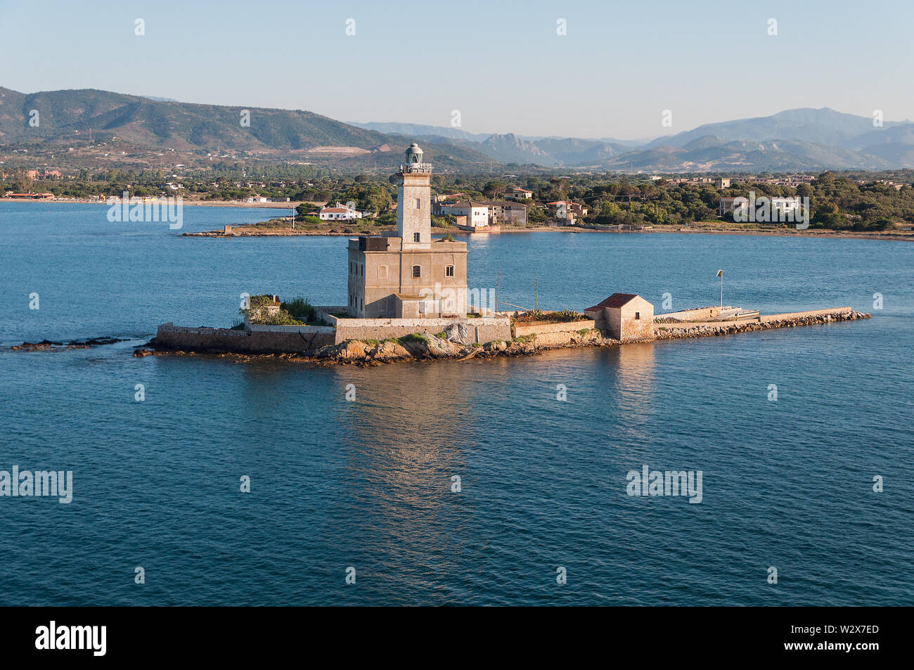 A view of lighthouse in Olbia gulf on sunset hour Stock Photo