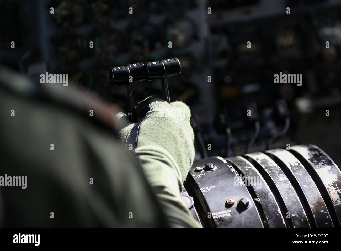 Details with the thrust lever on a military cargo airplane. - Stock Image