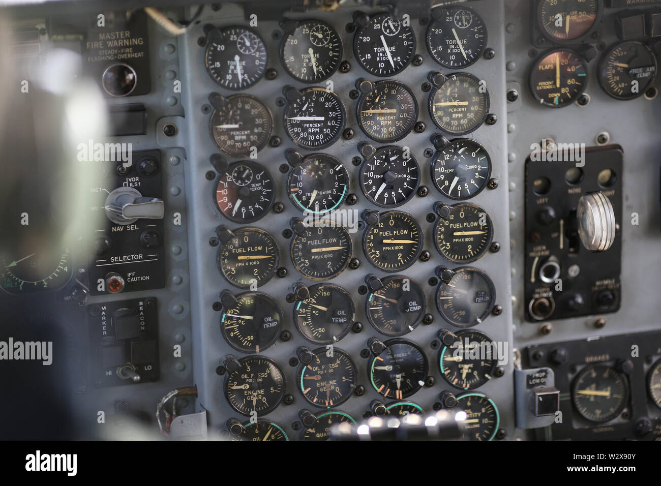 Details with the dials in the cockpit of a military cargo airplane. - Stock Image