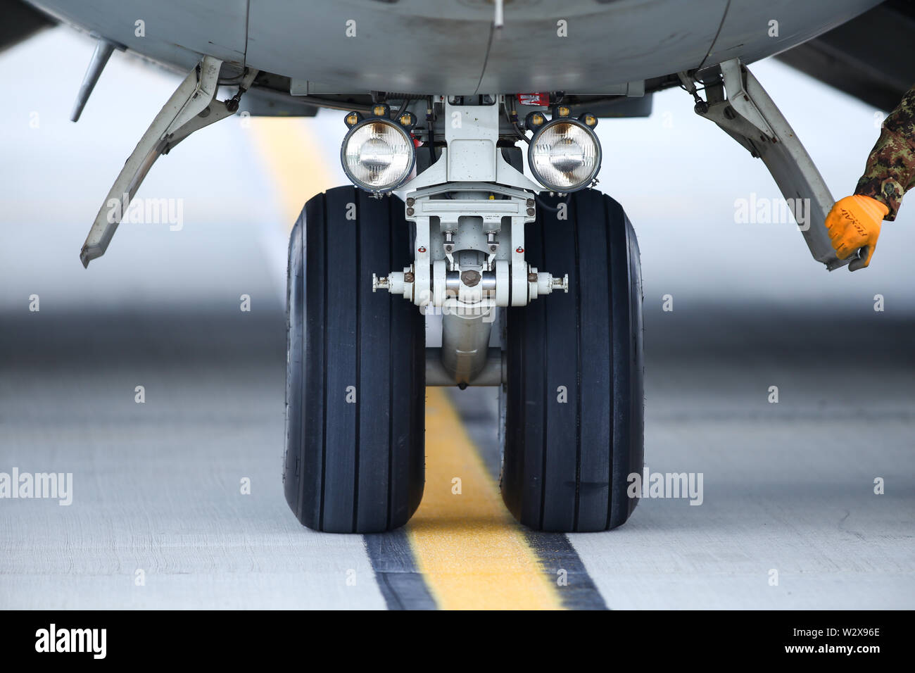 Details of the landing gear of a military cargo plane. - Stock Image