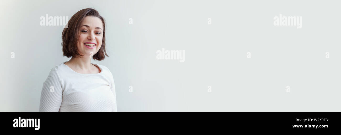 Happy girl smiling. Beauty portrait young happy positive laughing brunette woman on white background isolated. European woman. Positive human emotion - Stock Image