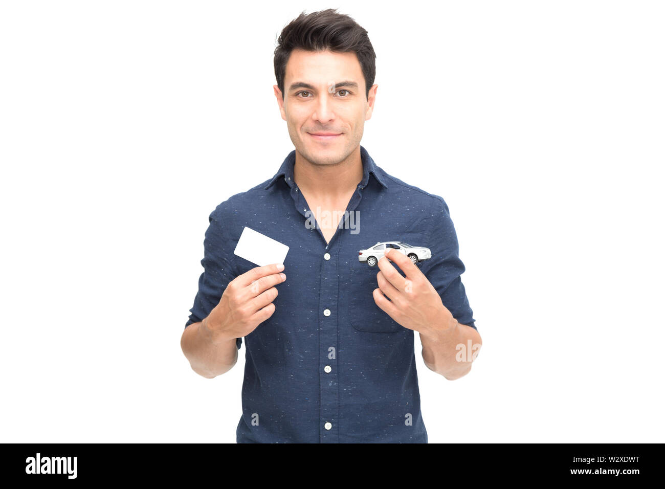 Young Caucasian man holding car insurance card isolated on white background - Stock Image