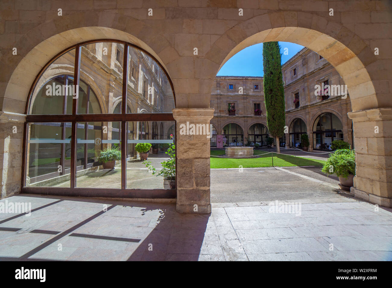 Leon, Spain - June 25th, 2019:  Collegiate of San Isidoro, Leon, Spain. Entrance cloister - Stock Image