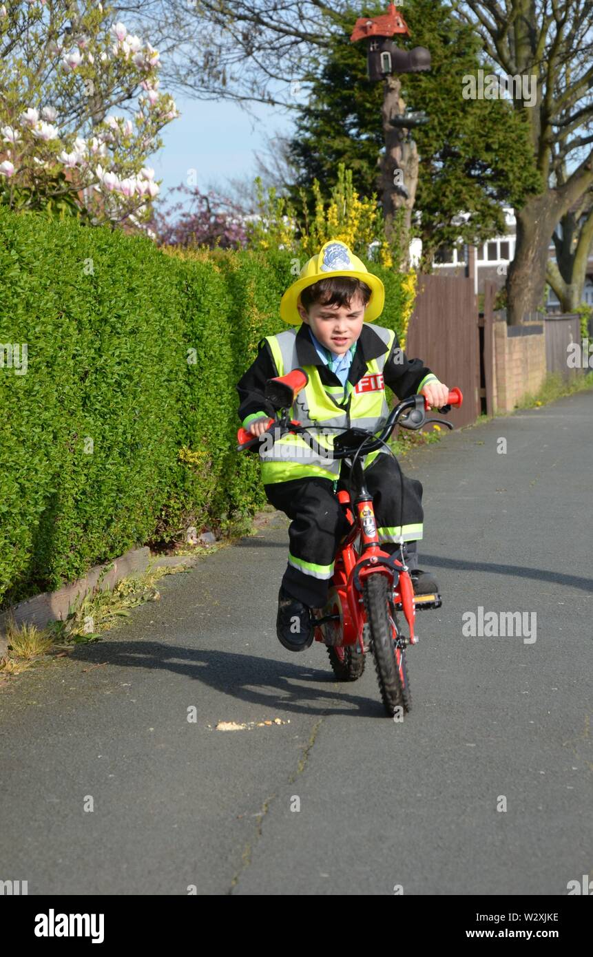 young boy dressed as a fire fighter, Role Play Stock Photo