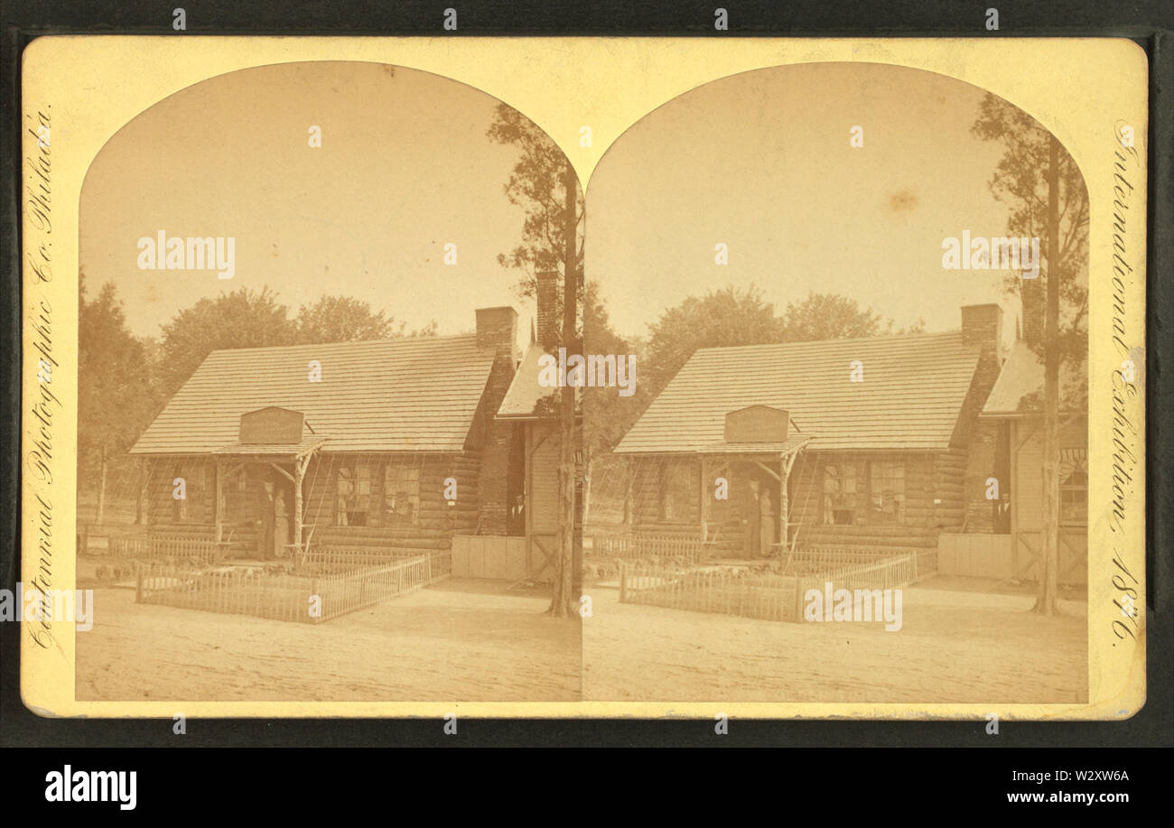 Log cabin in ye olden times, by Centennial Photographic Co 5 - Stock Image