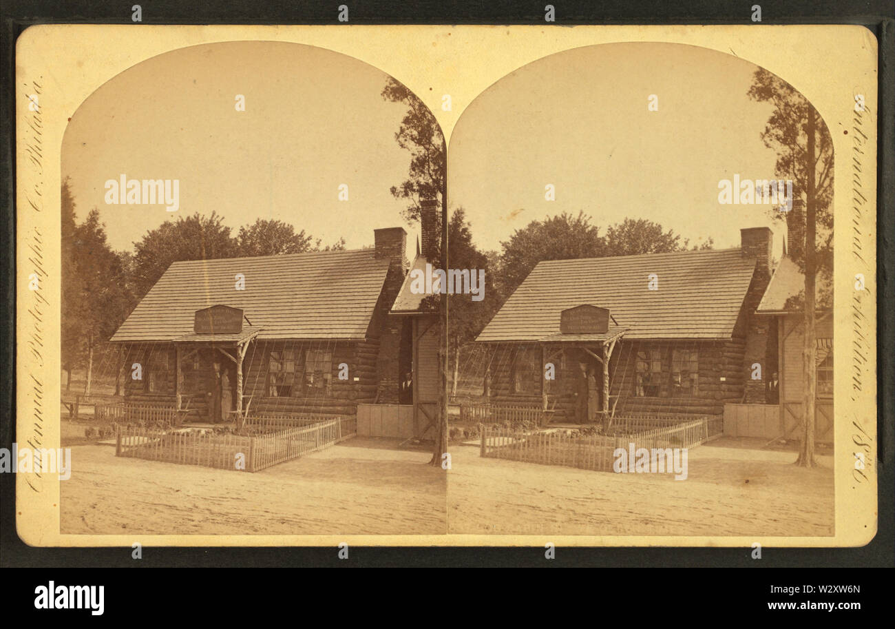 Log cabin in ye olden times, by Centennial Photographic Co 4 - Stock Image