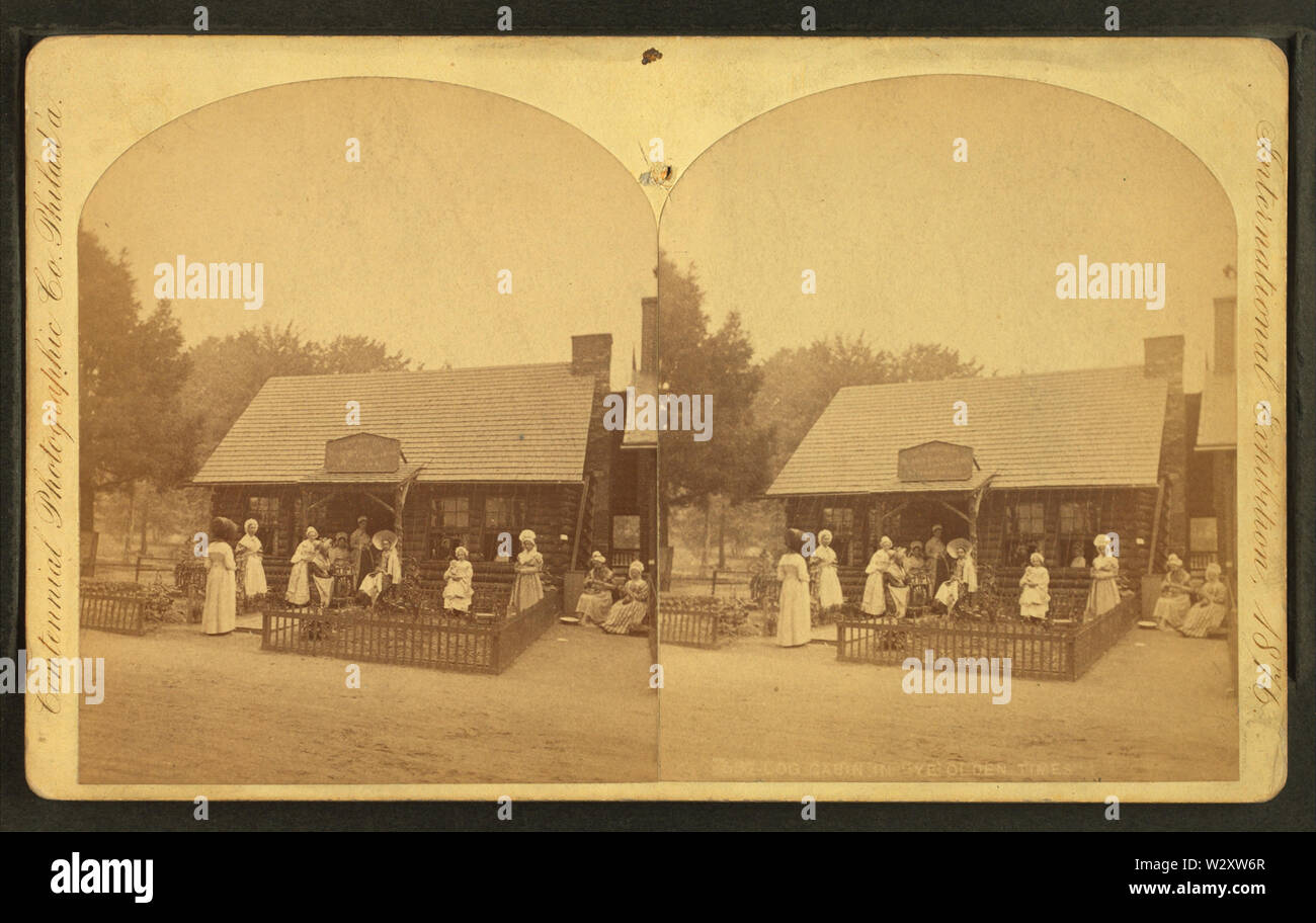 Log cabin in ye olden times, by Centennial Photographic Co 2 - Stock Image