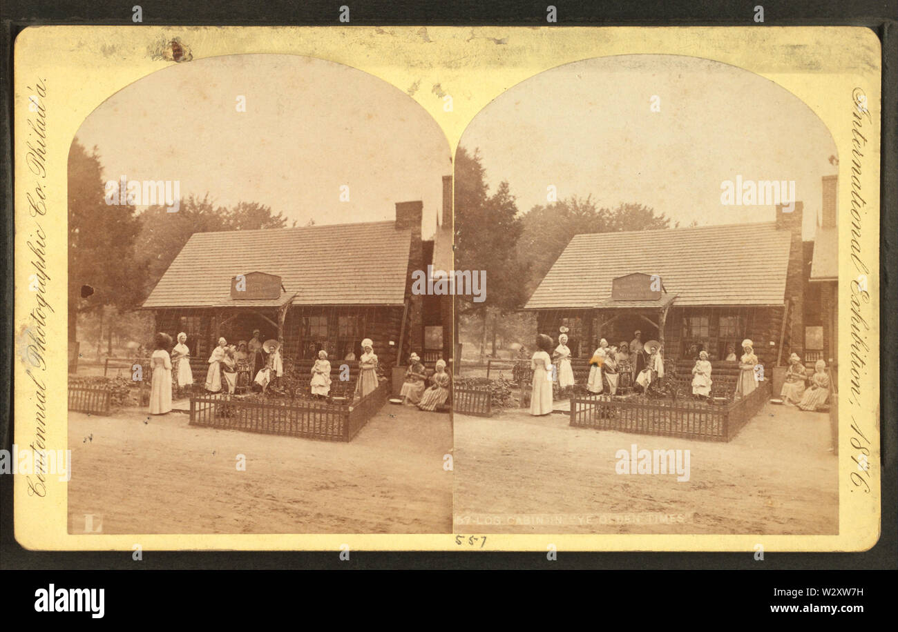 Log cabin in ye olden times, by Centennial Photographic Co - Stock Image